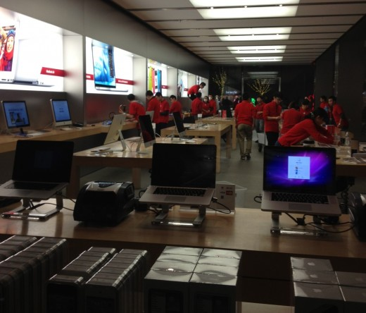 Apple Store workers during the launch at the Sanlitun Village store in Beijing, China.